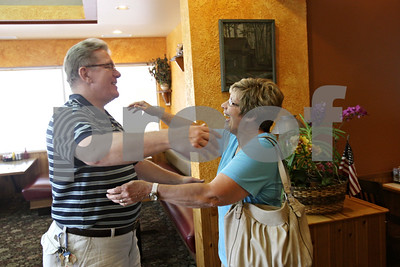 Rob Winner – rwinner@shawmedia.com  Dan Cornwall, of LaSalle, meets his sister Barbara Buck, of Brandon, South Dakota, for the first time at the Parkway Restaurant in Sycamore Thursday. Buck was put up for adoption when she was two months old.