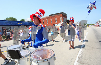 Kyle Bursaw – kbursaw@shawmedia.com  Matthew Winkler plays percussion with Hiawatha High School's marching band during Kirkland's Fourth of July parade.  Wednesday, July 4, 2012