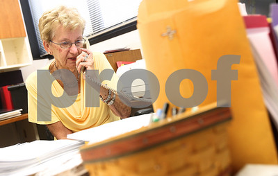 Kyle Bursaw – kbursaw@shawmedia.com  Patricia Siebrasse, the office manager for NIU's Family, Consumer and Nutrition Sciences, takes a phone call in her office  on Tuesday, July 3, 2012. Siebrasse is retiring after 50 years at NIU.