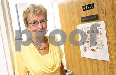 Kyle Bursaw – kbursaw@shawmedia.com  Patricia Siebrasse, the office manager for NIU's Family, Consumer and Nutrition Sciences, seen here in the doorway of her office on Tuesday, July 3, 2012, is retiring after 50 years of service. No one at NIU has been employed longer than her.
