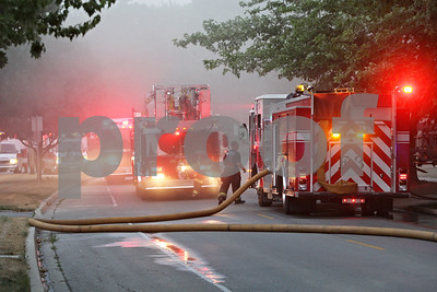 Rob Winner – rwinner@shawmedia.com  Emergency personnel respond to a fire at a home located on the 200 block of Miller Avenue in DeKalb Friday evening.