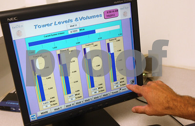 Kyle Bursaw – kbursaw@shawmedia.com  Bryan Faivre, assistant director of public works for DeKalb's Water Resources Division, shows off a program that monitors the levels in the city's four water towers on Thursday, July 5, 2012.