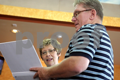 Rob Winner – rwinner@shawmedia.com  Barbara Buck, of Brandon, South Dakota, looks over a binder filled with genealogy with her brother Dan Cornwall, of LaSalle, at the Parkway Restaurant in Sycamore Thursday. Buck was put up for adoption when she was two months old.