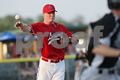 Rob Winner – rwinner@shawmedia.com  After fielding a ground ball, DeKalb County Liners pitcher Luke Harrison throws to first for an out in the top of the second inning during a game against DuPage County Thursday evening in Sycamore.