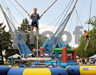 Josh Anderson, 12, of Shabbona, jumps on a bungee trampoline Saturday at the 11th annual Shabbona Hometown Festival.  By Nicole Weskerna - nweskena@shawmedia.com