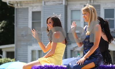 Kyle Bursaw – kbursaw@shawmedia.com  Kirkland Lions Club's queen Lauren Keneway (left) and one of the members of the court Jessica Campbell wave to those watching the Kirkland Fourth of July parade from their float.  Wednesday, July 4, 2012