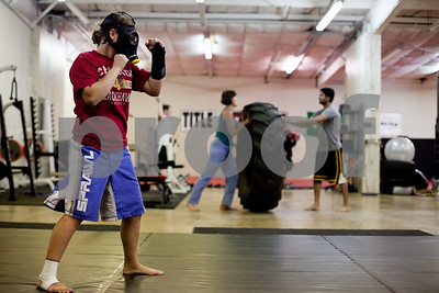 Kyle Bursaw – kbursaw@shawmedia.com  Danika uses a mask that reduces oxygen intake to simulate a higher elevation while training at United Mixed Martial Arts & Fitness on Thursday, June 7, 2012.