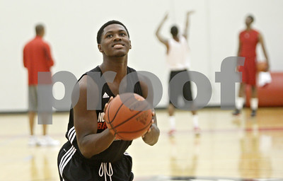 Rob Winner – rwinner@shawmedia.com  Northern Illinois freshman Akeem Springs practices his free throw shot  during a practice Tuesday in DeKalb.