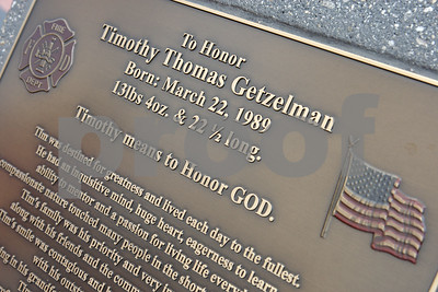 Rob Winner – rwinner@shawmedia.com  A plaque honoring Timothy Getzelman is seen near a flagpole outside Sycamore Fire Department Fire Station No. 2 Sunday afternoon.