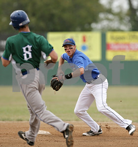 Rob Winner – rwinner@shawmedia.com  After stepping on the second base bag to retire Chicago Zephyrs baserunner Ryan Adams (8), DeKalb County Liners shortstop Brent Turner (right) throws to first base for a double play to end the top of the first inning in Sycamore Thursday, July 19, 2012.