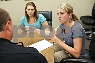 Rob Winner – rwinner@shawmedia.com  DeKalb Police Sgt. Jason Leverton (left) speaks with DeKalb County Youth Service Bureau clinical director Ahna Young (right) and intern Michelle McCabe Thursday afternoon at the DeKalb Police Department. DCYSB, which works with youths and their families, is still owed money from the state from fiscal year 2012.