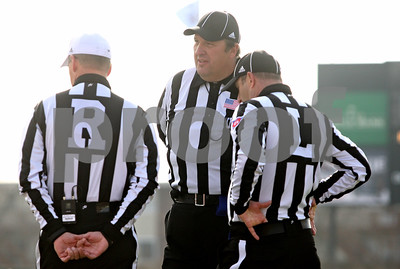 Rob Winner – rwinner@shawmedia.com  Three referees meet during a Northern Illinois football game on Friday, Nov. 25, 2011, in DeKalb.