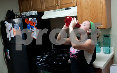 Kyle Bursaw – kbursaw@shawmedia.com  Danika Thibault downs a mixture of Muscle Milk and water in her father's kitchen on Wednesday, June 20, 2012. The shake is a high-protein addition to her regular diet.