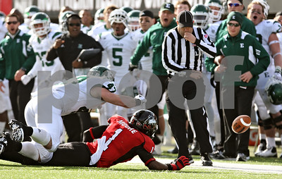 Rob Winner – rwinner@shawmedia.com  A referee watches as a pass intended for Northern Illinois receiver Martel Moore falls incomplete during a game against Eastern Michigan on Friday, Nov. 25, 2011, in DeKalb.