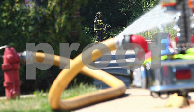 Kyle Bursaw – kbursaw@shawmedia.com  DeKalb firefighters spray down a gas leak on the 1000-block of West Lincoln Highway on Monday, July 9, 2012.