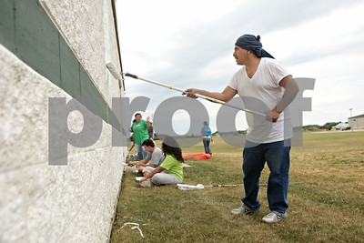 Rob Winner – rwinner@shawmedia.com  Erasmo Oviedo of Monterrey, Mexico helps paint the exterior of Cornerstone Christian Academy in Sycamore Tuesday afternoon. In past years members from Cornerstone went on missions to Monterrey, however with the recent violence there members of La Roca Church decided to head north to help those that have helped them in the past.