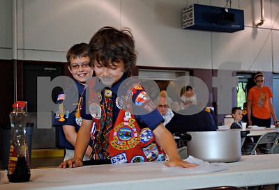 Jackson Feil, 10, (left) and Tristen Griesmann, 10, both members of Cub Scout Pack 345 in Sandwich, help wash tables at Sunday's seventh-annual pancake breakfast in Sandwich, which is hosted by the Cub Scouts.  By Nicole Weskerna - nweskerna@shawmedia.com