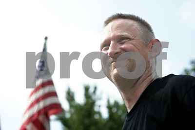 Rob Winner – rwinner@shawmedia.com  Master Sgt. Matthew Ruchti of the U.S. Air Force smiles as a crowd of family and friends welcome him home during a celebration at the Genoa Veterans Home Saturday. Ruchti served for 24 years and had tours in both Afghanistan and Iraq before retiring recently.