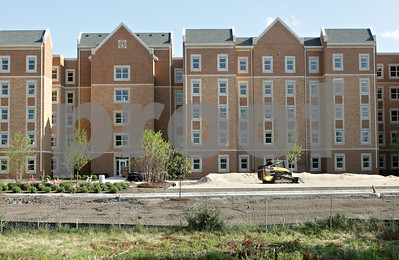 Rob Winner – rwinner@shawmedia.com  Construction continues on the new Northern Illinois University dormitory complex just north of Lincoln Hall on Wednesday, July 11, 2012.