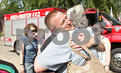 Rob Winner – rwinner@shawmedia.com  Master Sgt. Matthew Ruchti of the U.S. Air Force hugs his aunt Barbara Ruchti of Maple Park during a welcome home celebration at the Genoa Veterans Home Saturday. Ruchti served for 24 years and had tours in both Afghanistan and Iraq before retiring recently.