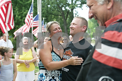 Rob Winner – rwinner@shawmedia.com  Jenny Cleveland of Kingston hugs her brother Master Sgt. Matthew Ruchti of the U.S. Air Force during a welcome home celebration at the Genoa Veterans Home Saturday. Ruchti served for 24 years and had tours in both Afghanistan and Iraq before retiring recently.
