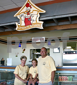 The Dietzig family opened the Chick'n Shack in Sycamore June 12. They specialize in chicken, ribs and seafood. Pictured are owners Veronica and Cordel Dietzig with their daughter, Caitlynne, 8. Co-owner Mike Davis is not pictured.  By Nicole Weskerna - nweskerna@shawmedia.com