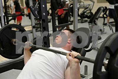Rob Winner – rwinner@shawmedia.com  Joe Diedrich works out in the weight room of DeKalb High School during practice Wednesday afternoon.
