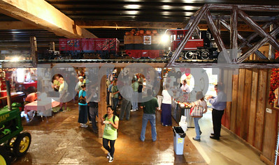 Kyle Bursaw – kbursaw@shawmedia.com  A train runs around the inside of one of the buildings in the Kuipers Family Farm as guests at the the 2012 Summer Horticulture Field Day look around on Thursday, June 14, 2012.