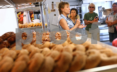 Kyle Bursaw – kbursaw@shawmedia.com  Kim Kuiper, co-owner of Kuipers Family Farm, explains some of their business practices to guests getting a behind-the-scenes look at their bakery operation during the 2012 Summer Horticulture Field Day on Thursday, June 14, 2012.