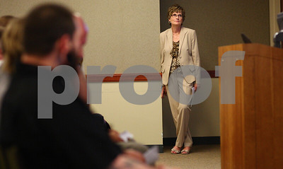 Kyle Bursaw – kbursaw@shawmedia.com  Presiding Judge Robbin Stuckert, the judge for the DeKalb County Drug/DUI court, watches the court's graduation ceremony from the side of a conference room in Kishwaukee Community Hospital on Friday, June 8, 2012.
