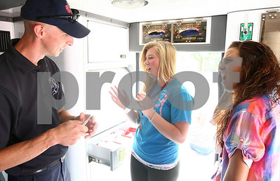 Kyle Bursaw – kbursaw@shawmedia.com  Emma Fillmore (center), 16 from DeKalb, and Sydney McCaslin, 17 from Sterling, react as DeKalb firefighter/paramedic Bob Terry answers their question with a story about an emergency he responded to. Terry and three other members of the DeKalb Fire Department were at NIU for the Rural Health Careers Camp on Wednesday, June 13, 2012.