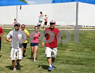 Jeff Engelhardt – jengelhardt@shawmedia.com Special Olympic athlete David Roberts carries the torch to Hopkins Park Sunday during the annual Illinois Law Enforcement Torch Run.