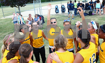 Kyle Bursaw – kbursaw@shawmedia.com  Sycamore Flash 14U players get pumped up before their game against the Roselle Rampage on Friday, June 22, 2012.