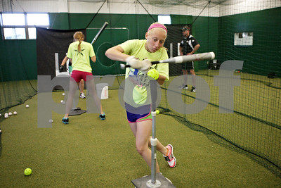 Rob Winner – rwinner@shawmedia.com  Tristyn Criswell of the Kishwaukee Valley Storm 16U team works on her swing while using a tee during practice Tuesday evening at their indoor facility in DeKalb.