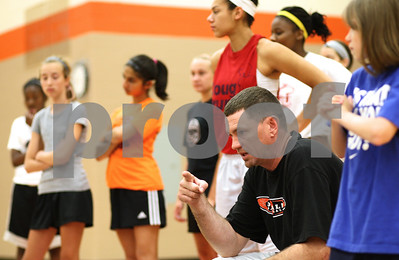 Kyle Bursaw – kbursaw@shawmedia.com  Chris Davenport, with some help from some members of the DeKalb varsity girls basketball team, coaches a youth basketball camp held at DeKalb High school on Friday, June 15, 2012.  pending approval at a June 19 meeting, he will be the new girls basketball coach at DHS.