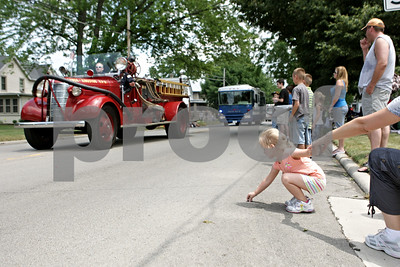 Rob Winner – rwinner@shawmedia.com  Clover Norris, 4 of Genoa, reaches for a piece of candy on Main Street during the Genoa Days parade Saturday afternoon.