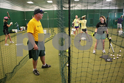 Rob Winner – rwinner@shawmedia.com  Kishwaukee Valley Storm 16U coach Bill Becker instructs Baylie Petit (right) during a team practice Tuesday evening at their indoor facility in DeKalb.