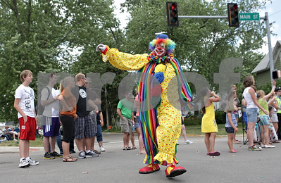 Rob Winner – rwinner@shawmedia.com  A Shriners clown waves to the crowd while participating in the Genoa Days parade Saturday afternoon.