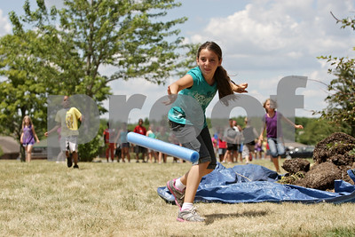 Rob Winner – rwinner@shawmedia.com  Nadia Timm, 10, tosses a pool noodle while participating in a javelin toss contest during Olympic Day at the Kishwaukee Family YMCA Friday afternoon.