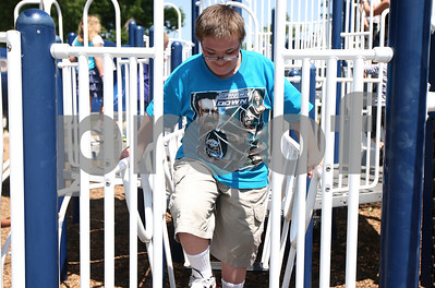 Kyle Bursaw – kbursaw@shawmedia.com  J.T. Baine, 13, roams the Hopkins Park playground under the supervision of the Camp Maple Leaf counselors on Monday, June 18, 2012.