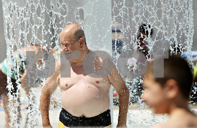 Rob Winner – rwinner@shawmedia.com  DeKalb resident Manuel Mekjian cools off within the wading area of the Hopkins Park pool in DeKalb Friday, June 15.