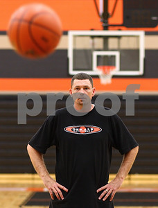 Kyle Bursaw – kbursaw@shawmedia.com  Chris Davenport oversees a drill while coaching a youth basketball camp held at DeKalb High school on Friday, June 15, 2012.  pending approval at a June 19 meeting, he will be the new girls basketball coach at DHS.