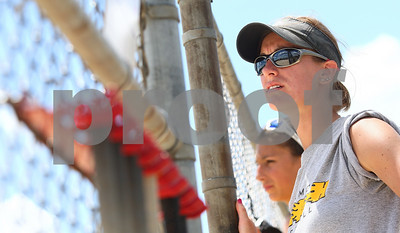 Kyle Bursaw – kbursaw@shawmedia.com  Sycamore Flash 14U assistant coach Cris Zakosek looks on at her team as they play against the Roselle Rampage Friday, June 22, 2012.