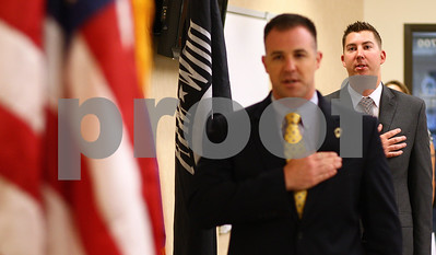 Kyle Bursaw – kbursaw@shawmedia.com  Simon Wlodarski (front), chief of staff for the Illinois Department of Veterans' Affairs, and Steven Kreitzer recite the Pledge of Allegiance at the very beginning of a press conference where DeKalb resident Kreitzer was presented with the Veteran of the Month Award from the IDVA on Monday, June 18, 2012.