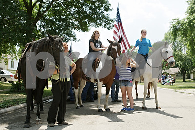 Rob Winner – rwinner@shawmedia.com  Horseback riders take their place in line along South Hadsall Street before the Genoa Days parade Saturday afternoon.