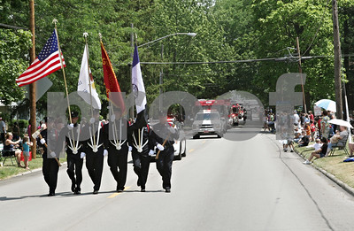 Rob Winner – rwinner@shawmedia.com  The color guard make their way west along Main Street during the Genoa Days parade Saturday afternoon.