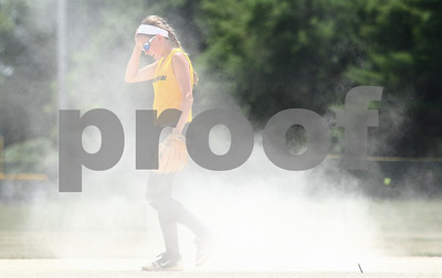 Kyle Bursaw – kbursaw@shawmedia.com  Sycamore Flash 14U player Bailey Fank walks back to position after a Roselle Rampage player slid into second base,  a cloud of dust kicked up follows her on Friday, June 22, 2012.