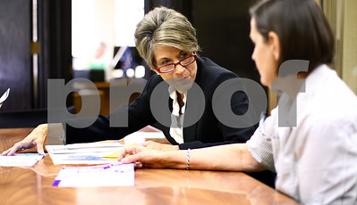 Kyle Bursaw – kbursaw@shawmedia.com  Micki Chulick, executive director of 4-C, Pam Wicking (right) and other 4-C staffers discuss feedback they've gotten on their informational brochures on Friday, June 15, 2012. Chulick will be retiring on June 30 at the end of 4-C's fiscal year.
