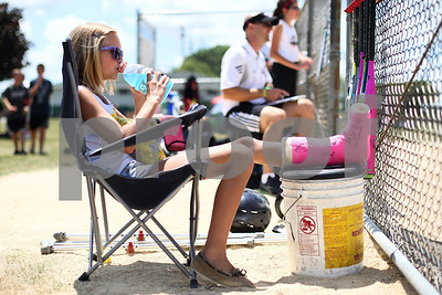 Kyle Bursaw – kbursaw@shawmedia.com  Kishwaukee Valley Storm 12U player Caelin O'Higgins takes a drink while watching her teammates during one of their games on Friday, June 22, 2012.