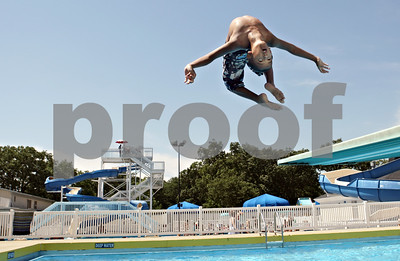 Rob Winner – rwinner@shawmedia.com  Jadyn Thompson, 10 of DeKalb, performs a backflip off a diving board while spending the afternoon at the Hopkins Park pool on Friday afternoon.
